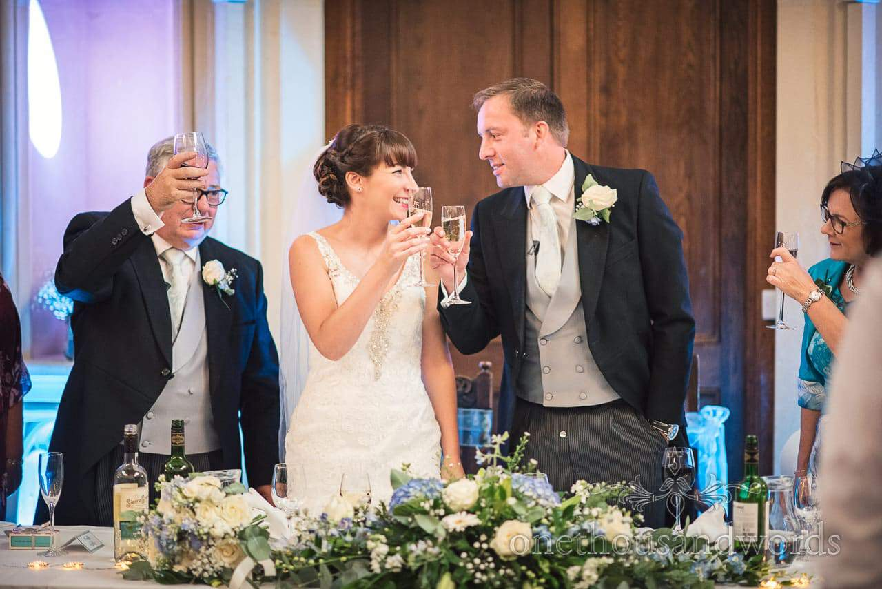 Bride and groom raise a toast at Canford School Wedding Photographs