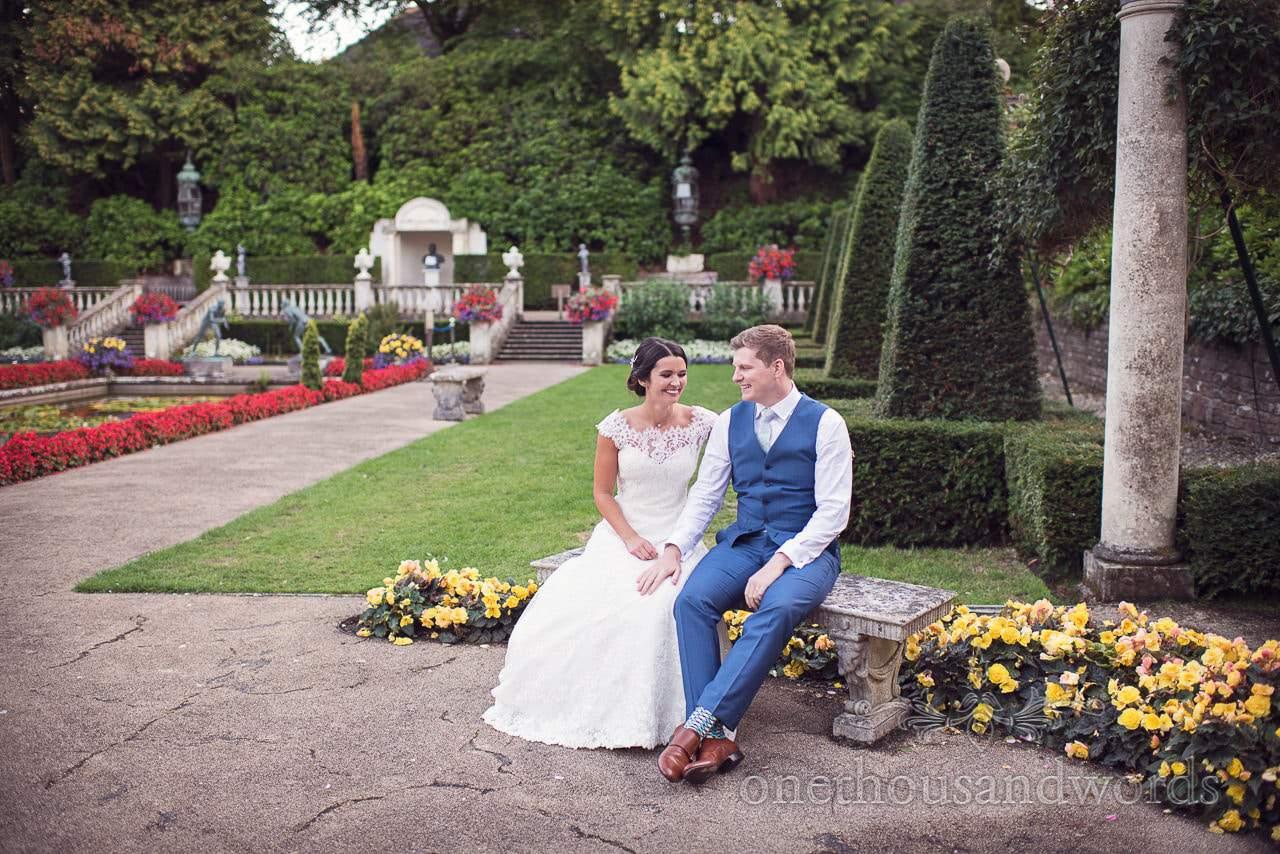 Bride and groom take five minutes out in Italian Villa Wedding venue garden