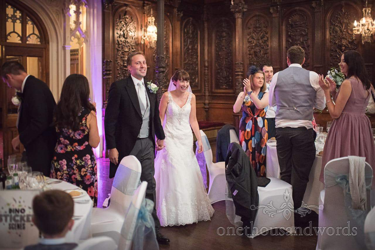 Bride and groom welcomed into the great hall at Canford School Wedding Photographs