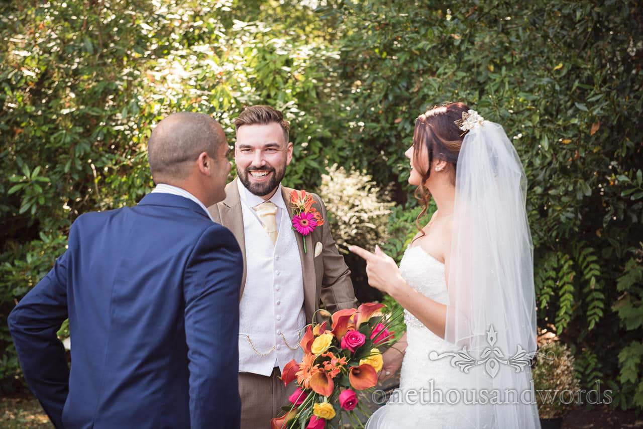 Bride and groom with guest in garden at the Old Vicarage Wedding