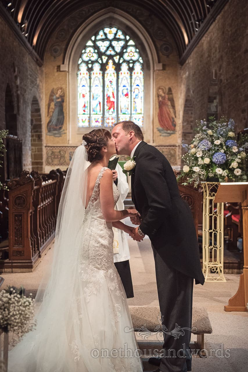 Bride and grooms first kiss from Canford School Wedding Photographs