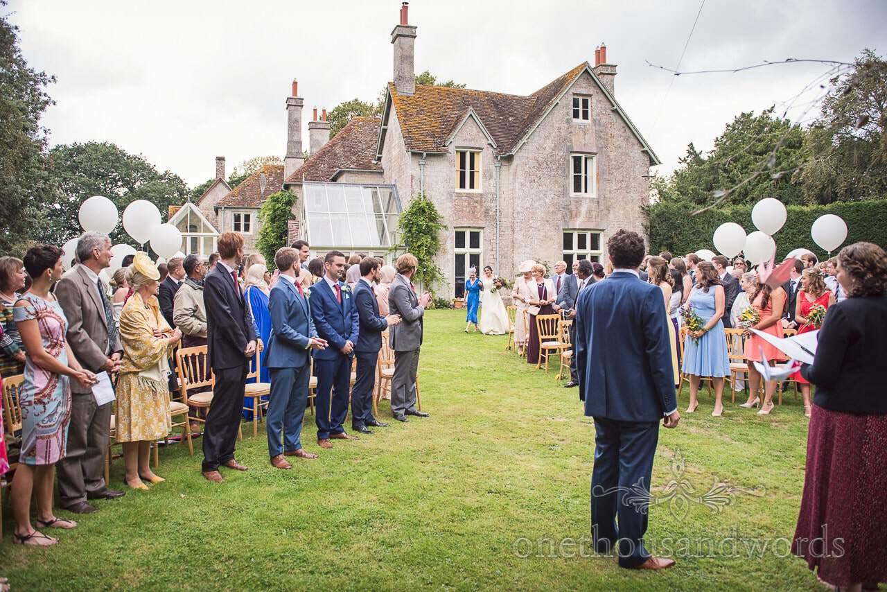 Bride and mother arrive for Dorset garden wedding