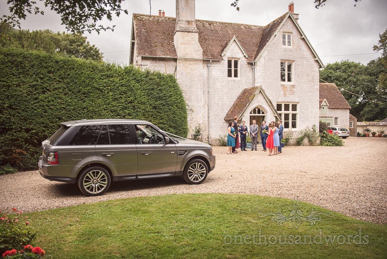 Bride arrives in Range Rover at Dorset Garden Wedding