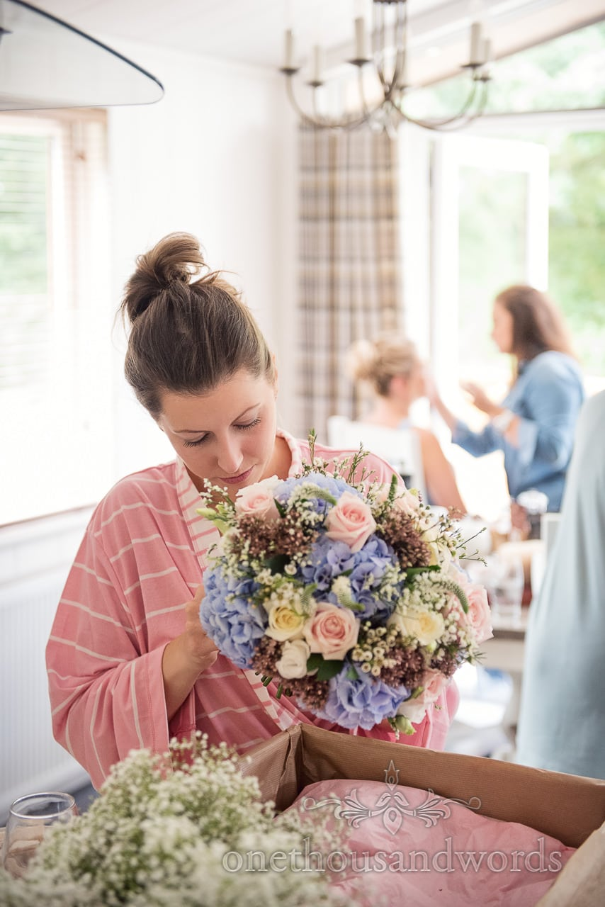 Bride with bridal bouquet during wedding morning