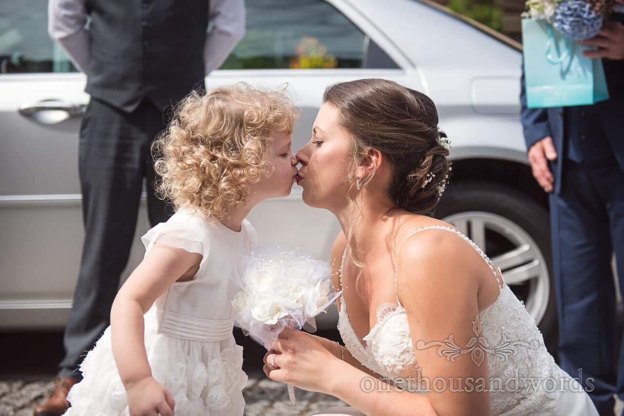Bride and daughter kiss before ceremony at Italian Villa Wedding Photos