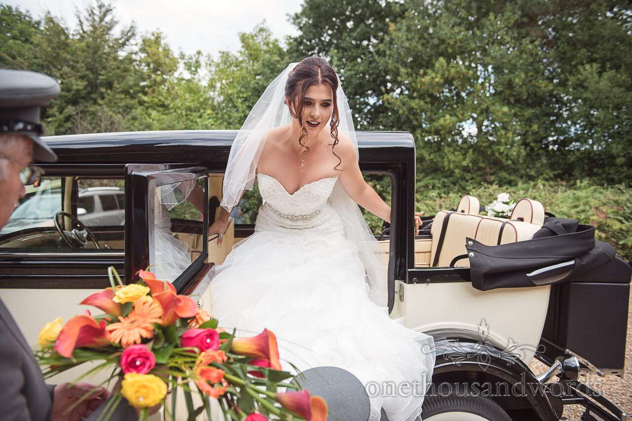 Bride exits classic wedding car at The Old Vicarage Wedding Photographs