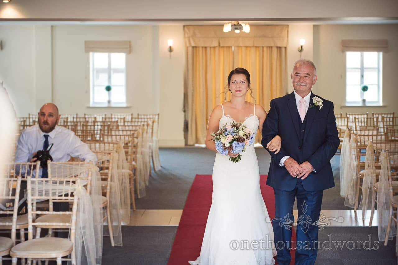 Bride and father walk down the aisle during civil ceremony at Italian Villa Wedding Venue Photos