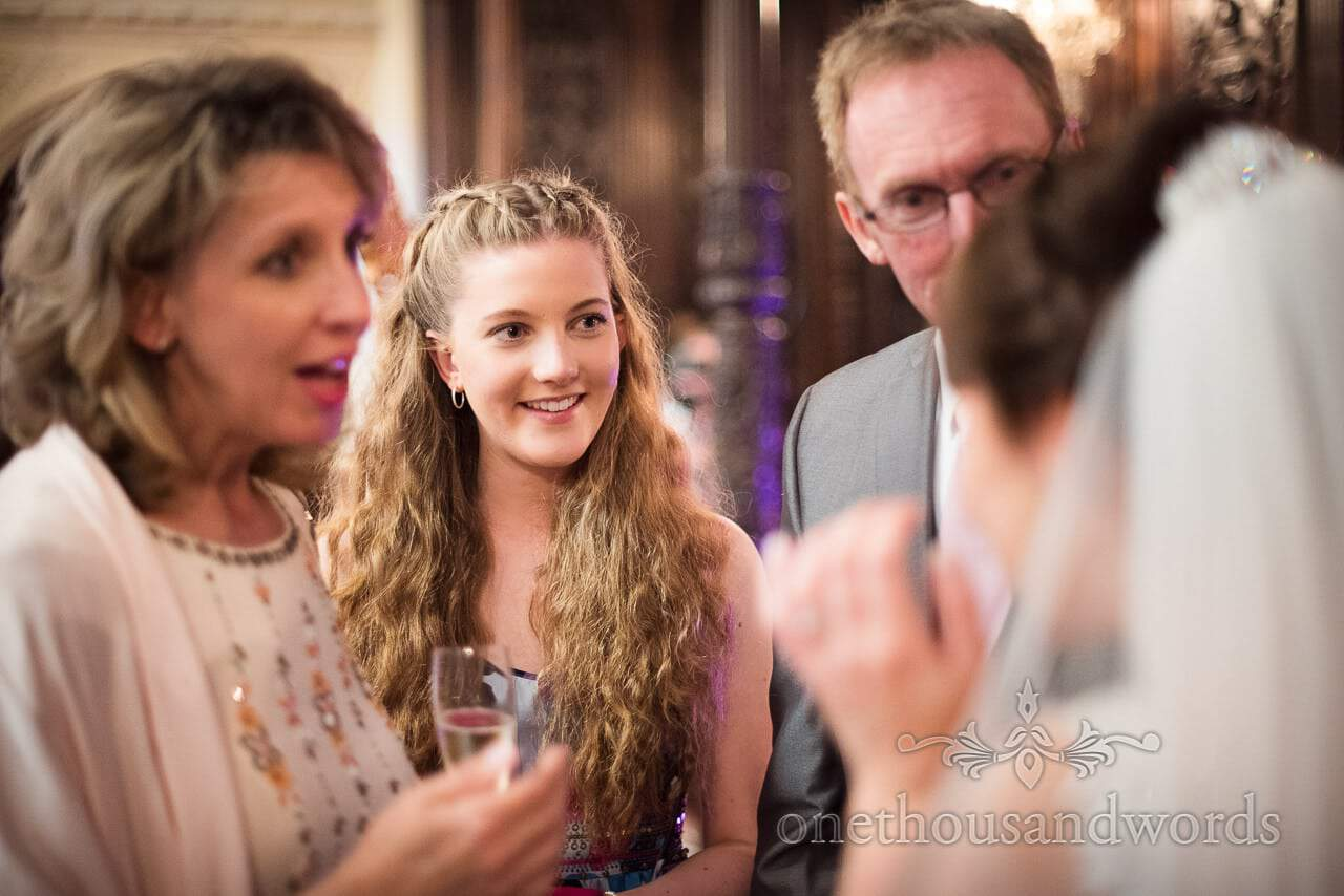 Bride greets guests in reviving line at Canford School Wedding