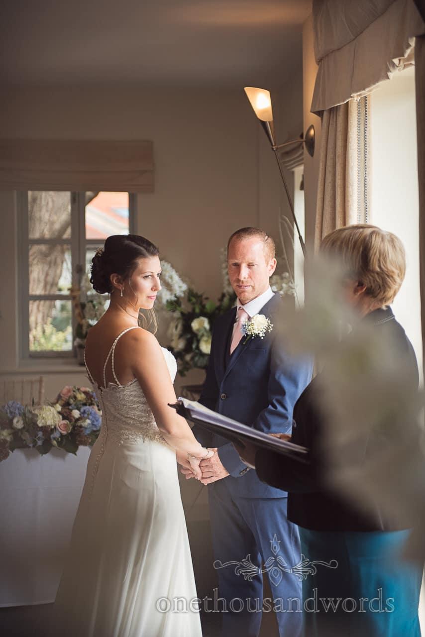 Bride and groom during civil ceremony at Italian Villa Wedding Venue Photos