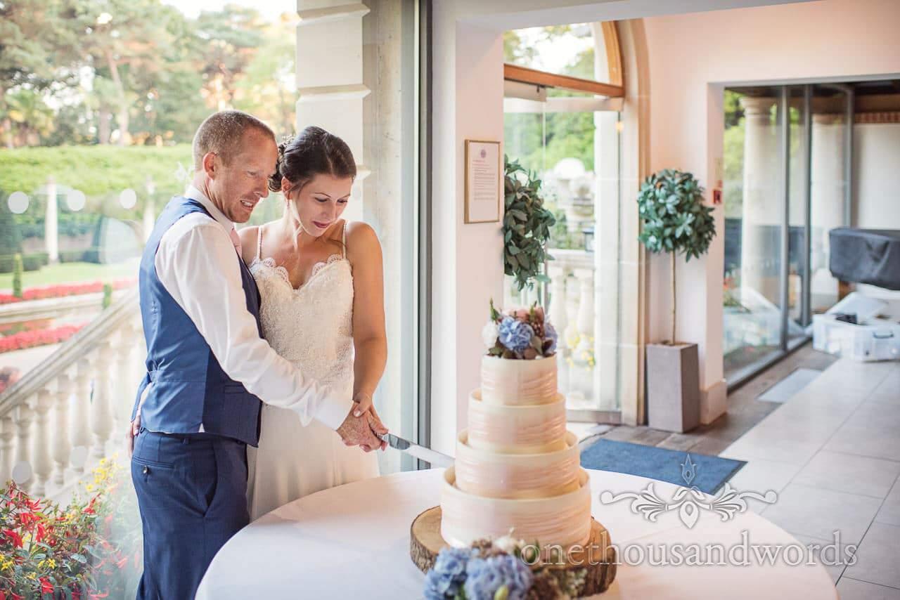 Bride and groom cut the cake at the Italian Villa Wedding venue photos