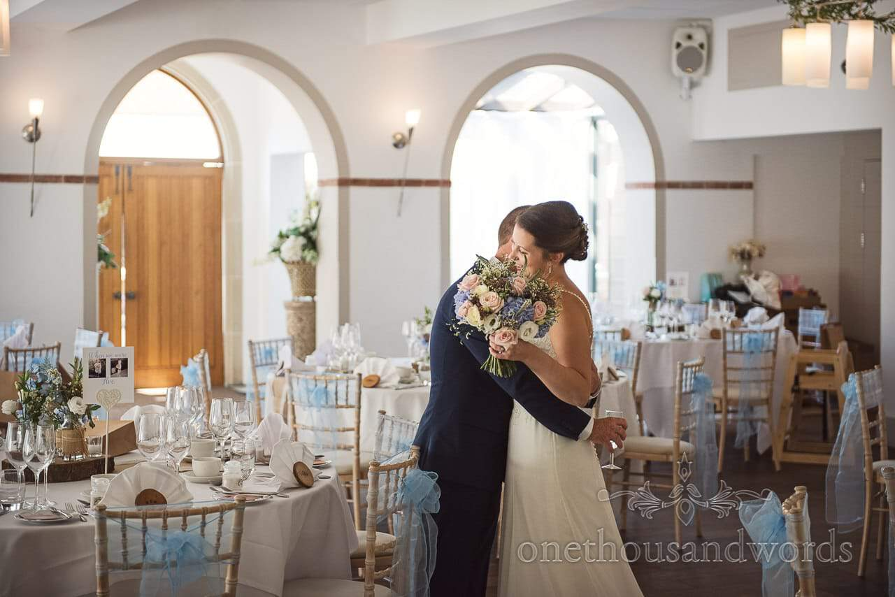 Bride and groom embrace after civil ceremony at Italian Villa Wedding venue photos