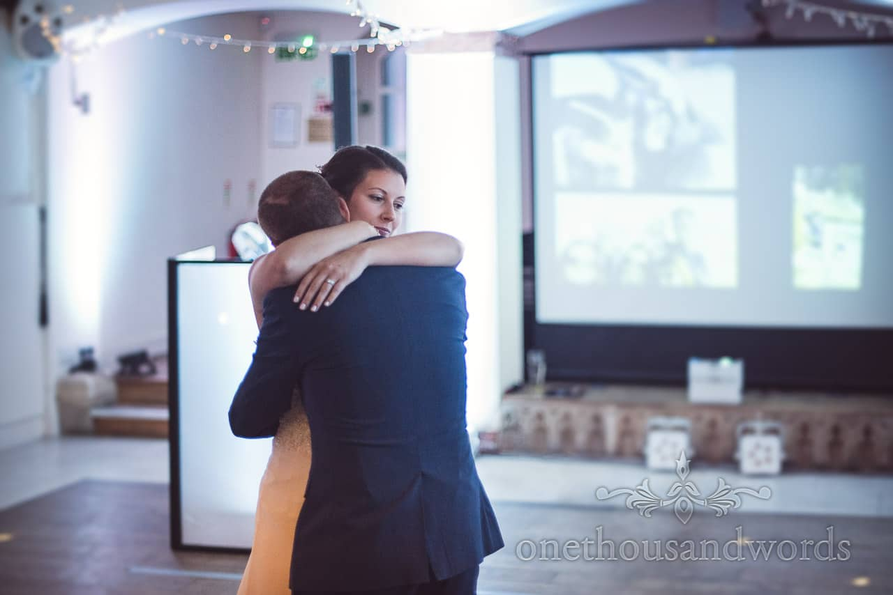 Bride and groom embrace during first dance at Italian Villa Wedding