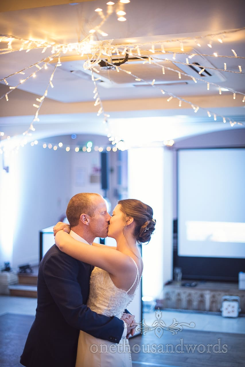 Bride and groom kiss during first dance at Italian Villa Wedding