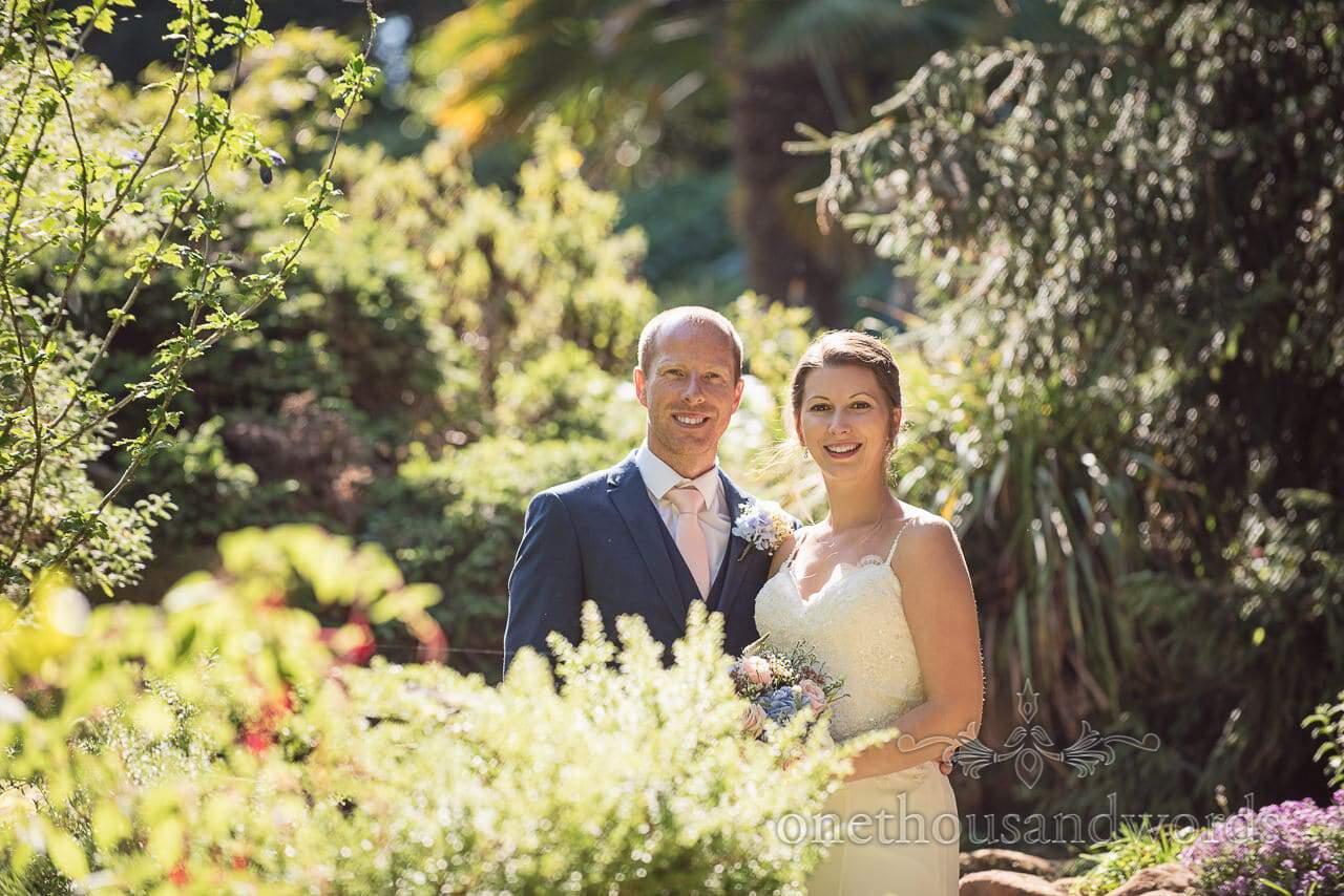 Bride and groom in sunlit gardens at the Italian Villa Wedding