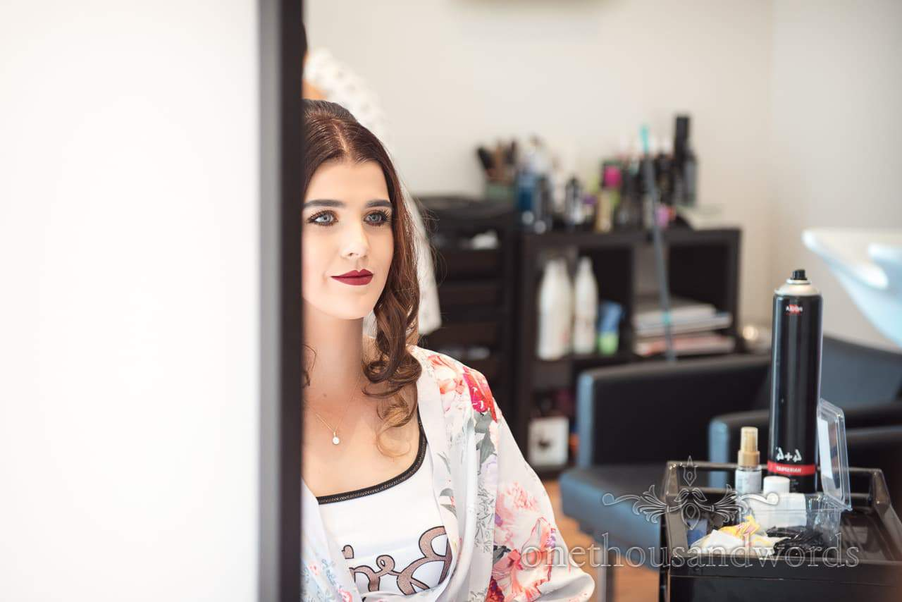 Bride in mirror at salon on morning of Old Vicarage Wedding