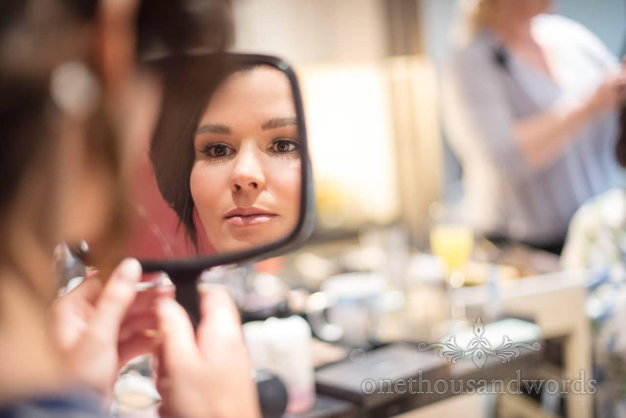 Bride in mirror during morning preparations before Italian Villa Wedding