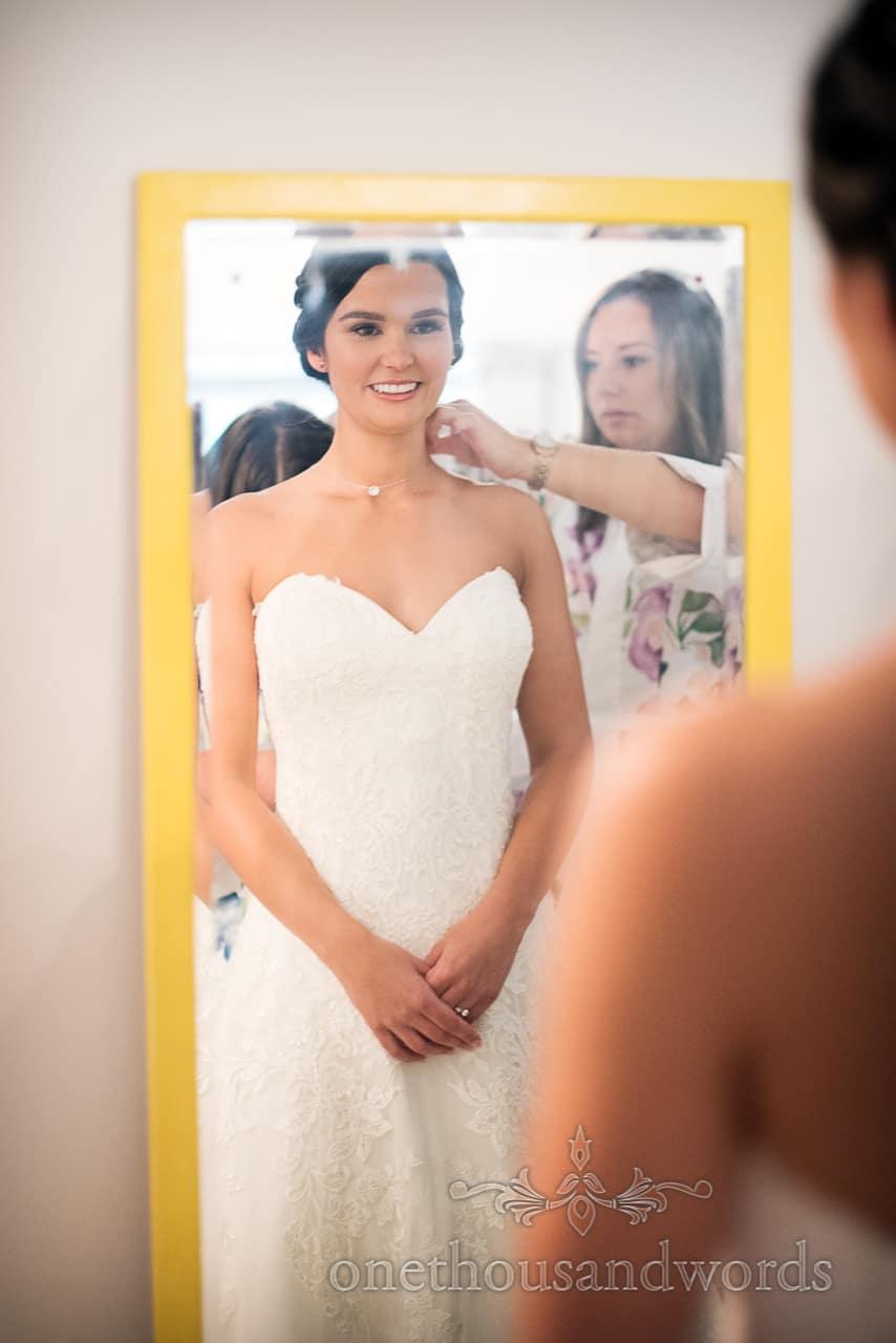 Bride in wedding dress in mirror before Italian Villa Wedding venue