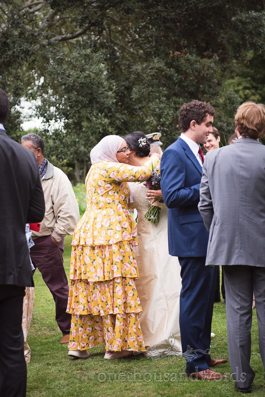 Bride is embraced by family member at Dorset garden wedding
