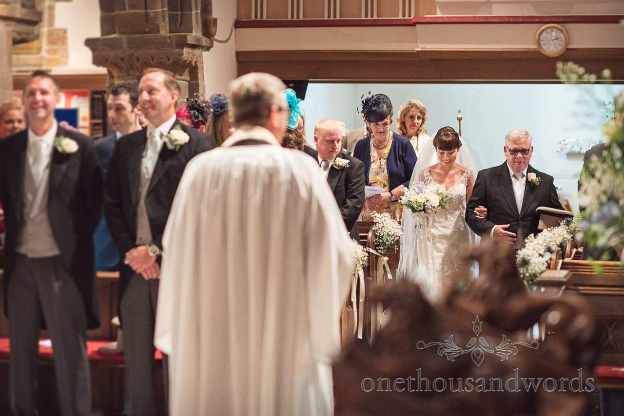 Bride is escorted down the aisle at Canford School Wedding