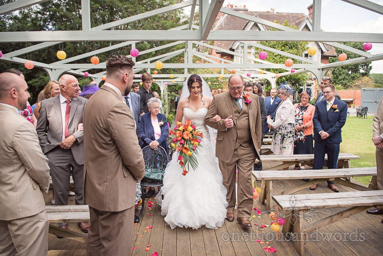 Bride is escorted down the aisle by father at Old Vicarage Wedding Photographs