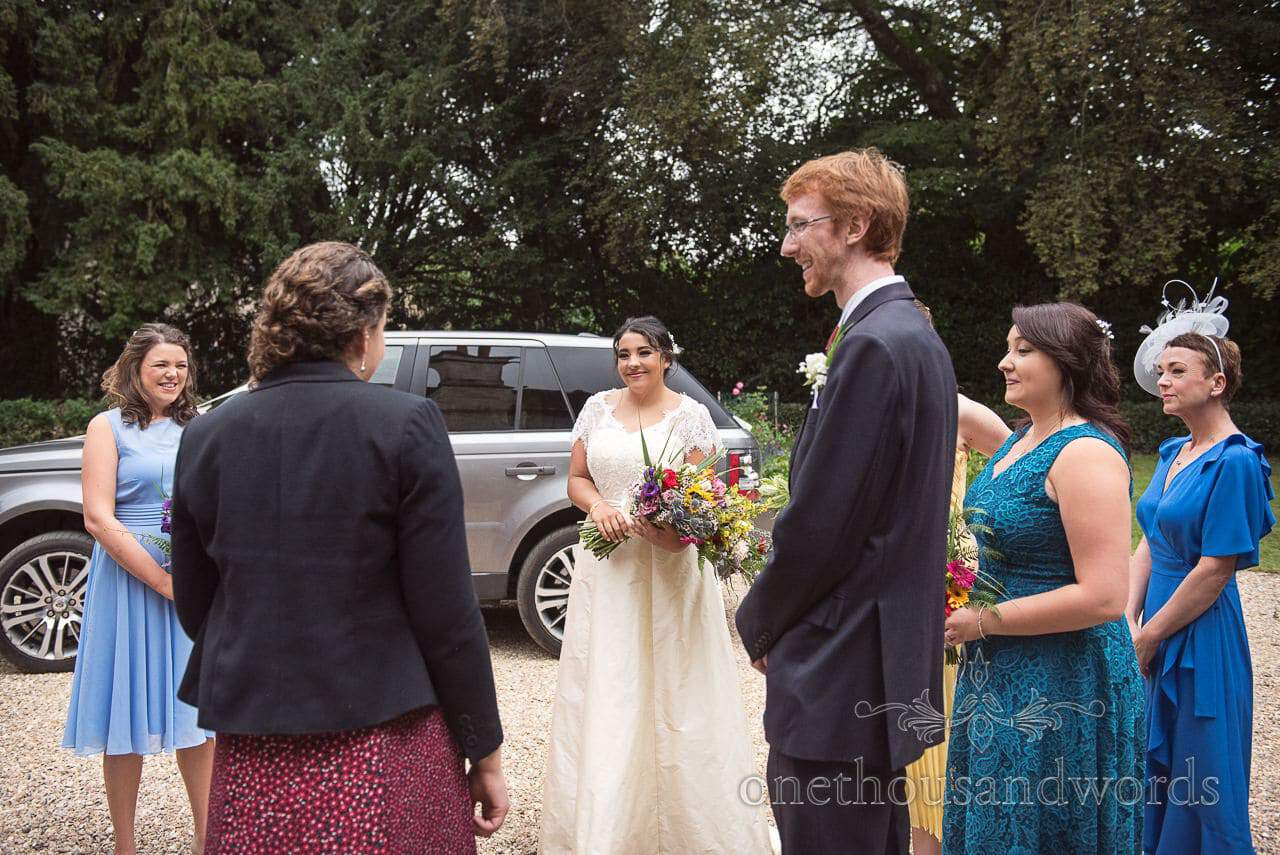 Bride is greeted by celebrant at Dorset Garden Wedding