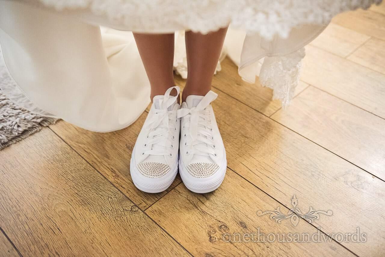 Bride lifts dress to show custom wedding kicks from Italian Villa Wedding