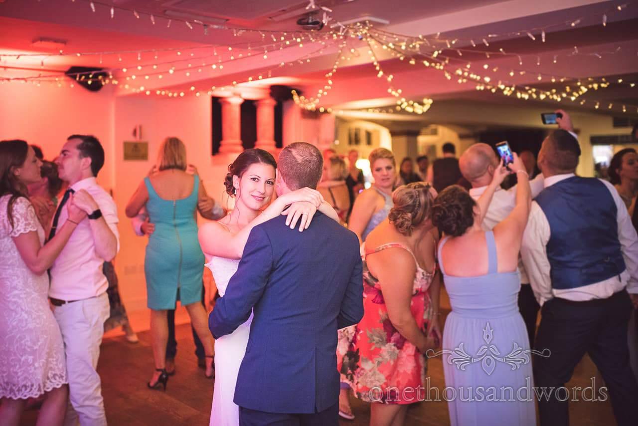 Bride looks as guests take selfies at Italian Villa Wedding