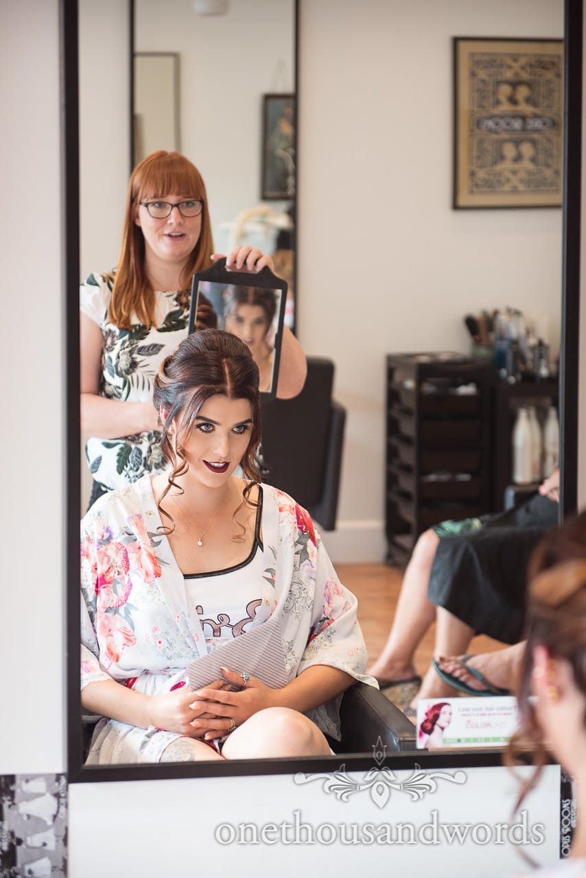 Bride looks in mirror at salon before the Old Vicarage Wedding