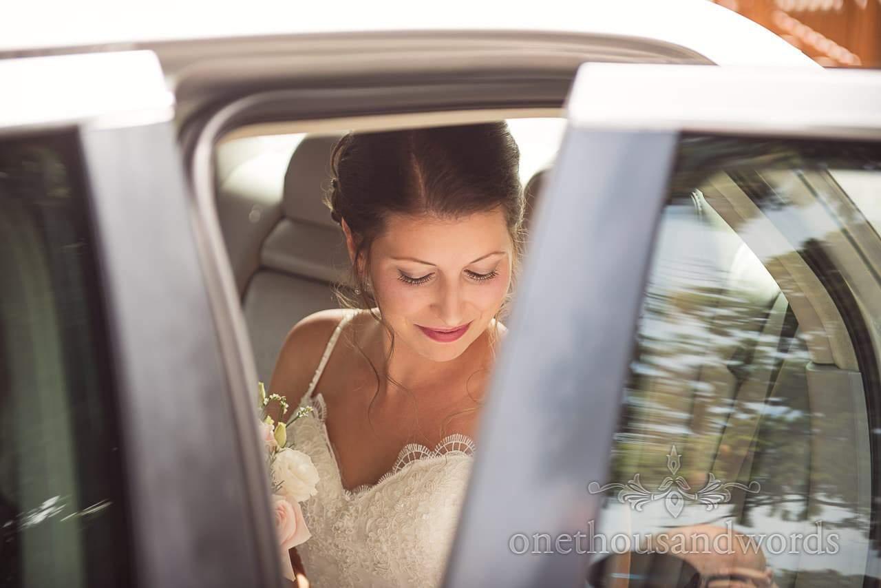 Bride in wedding car on morning at the Italian Villa Wedding