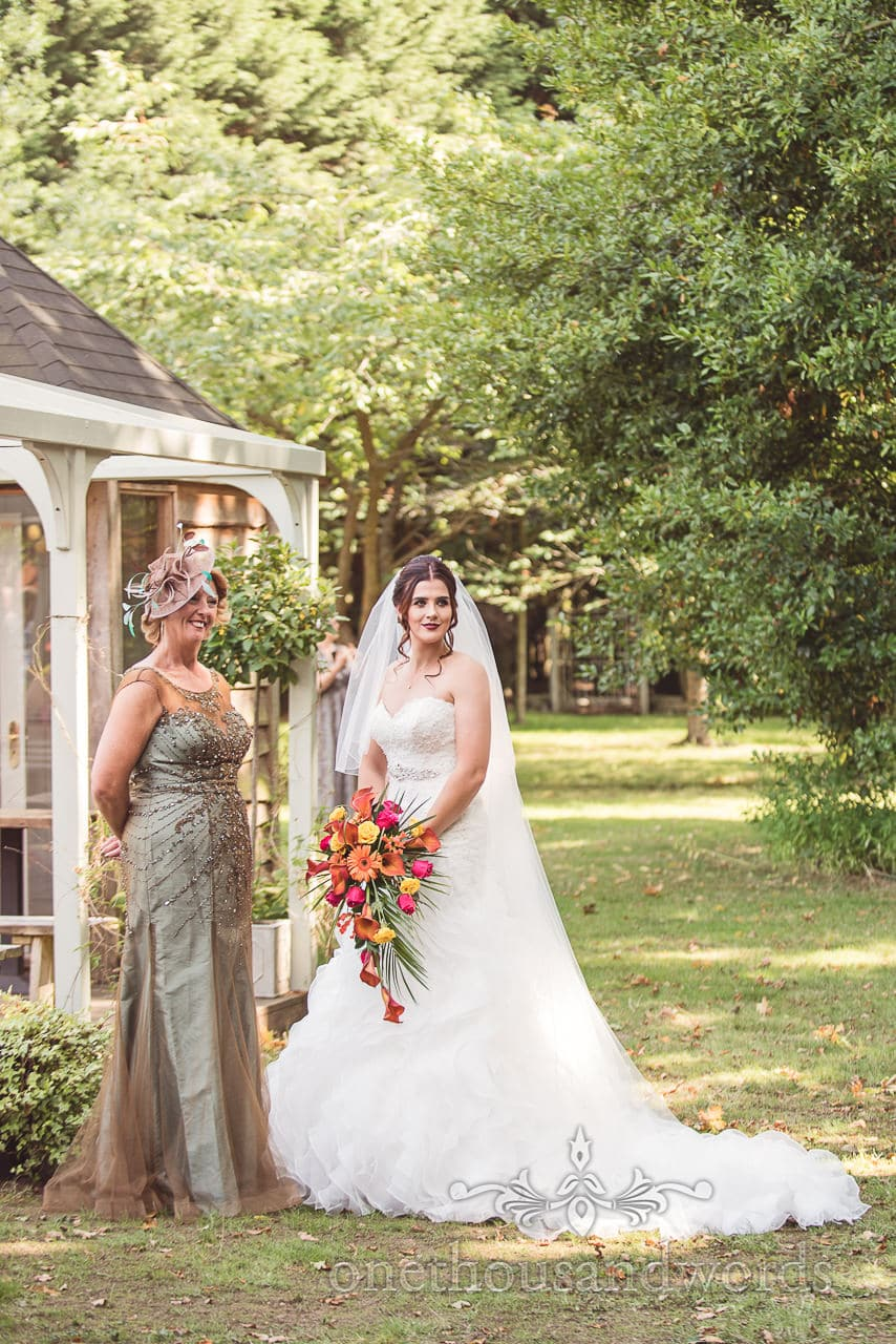 Bride with mother in garden at The Old Vicarage Wedding Photographs
