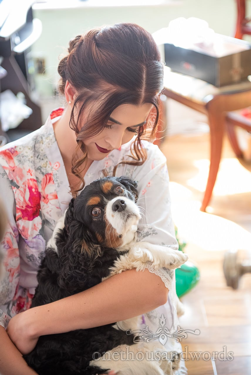 Bride with pet dog before Old Vicarage Wedding