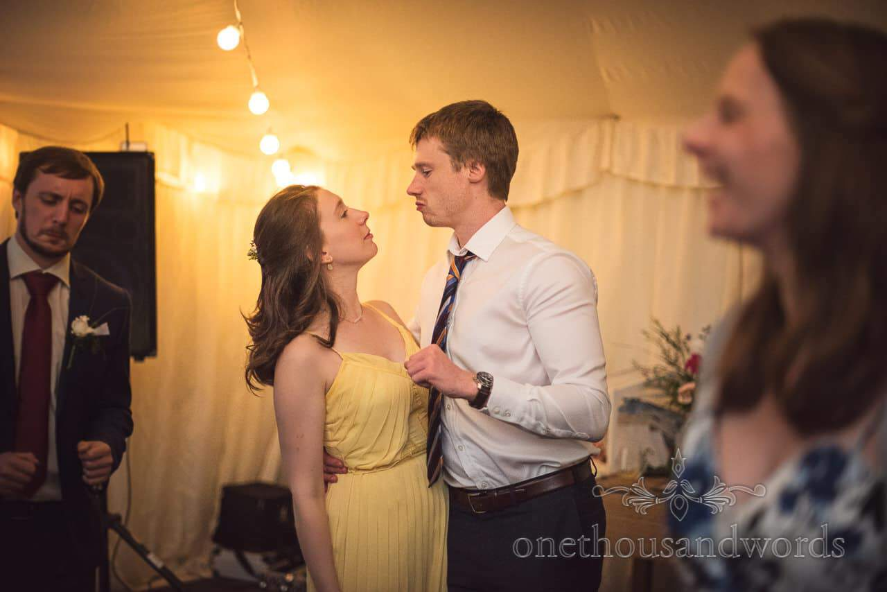 Bridesmaid and guest on dance floor during marquee wedding reception
