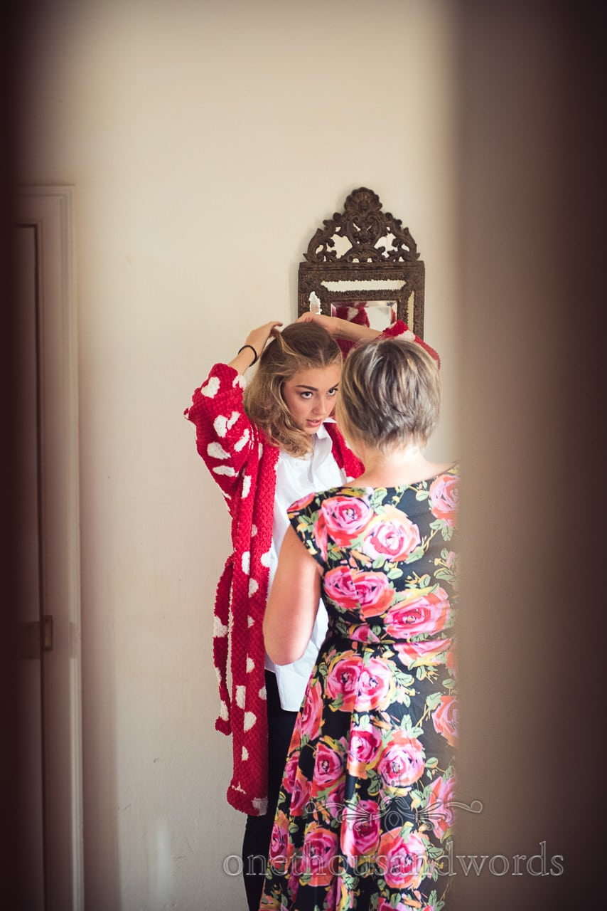 Bridesmaid during morning preparation at Woodsford castle