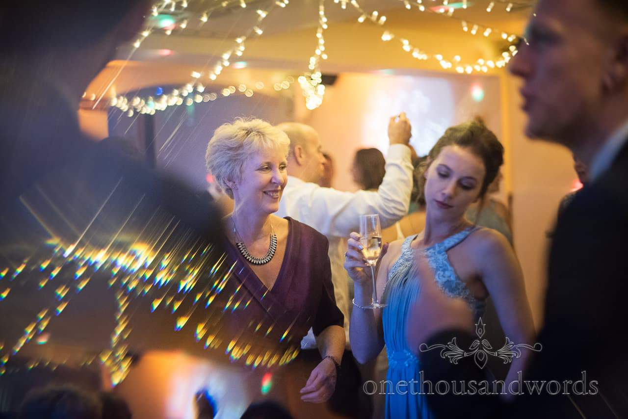 Bridesmaid and guests on dance floor during evening reception at Italian Villa