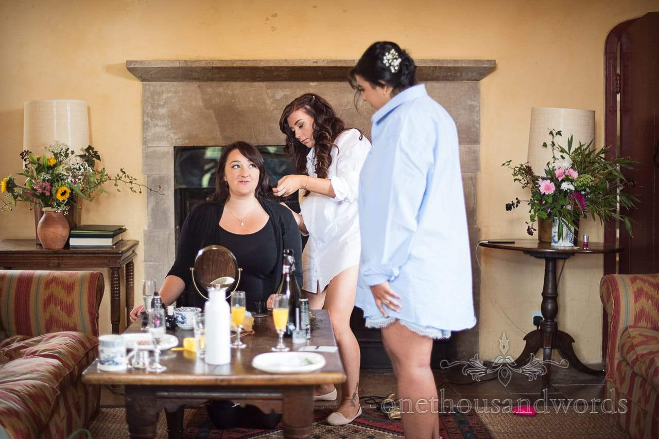 Bridesmaid has hair styled by bridesmaid at Woodsford castle