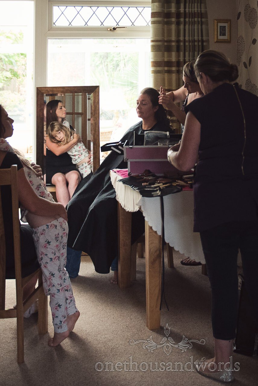 Bridesmaid has hair styled on morning of Canford School Wedding