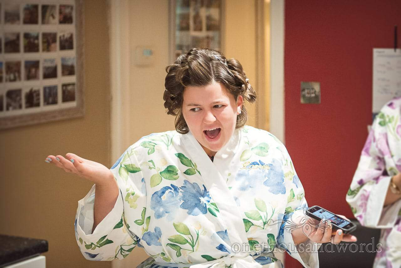 Bridesmaid in floral patterned dressing gown on morning of Italian Villa Wedding