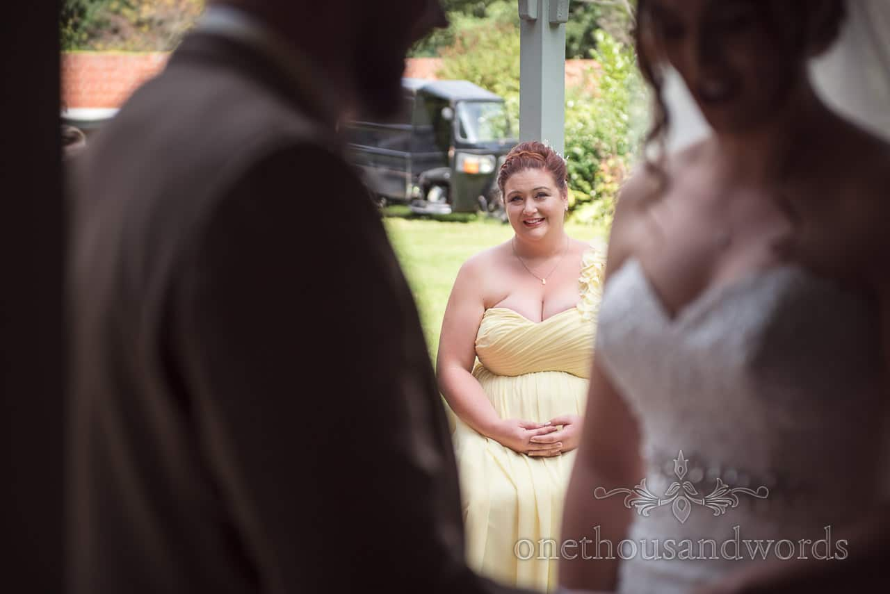 Bridesmaid looks on during outdoor ceremony at The Old Vicarage Wedding Photographs