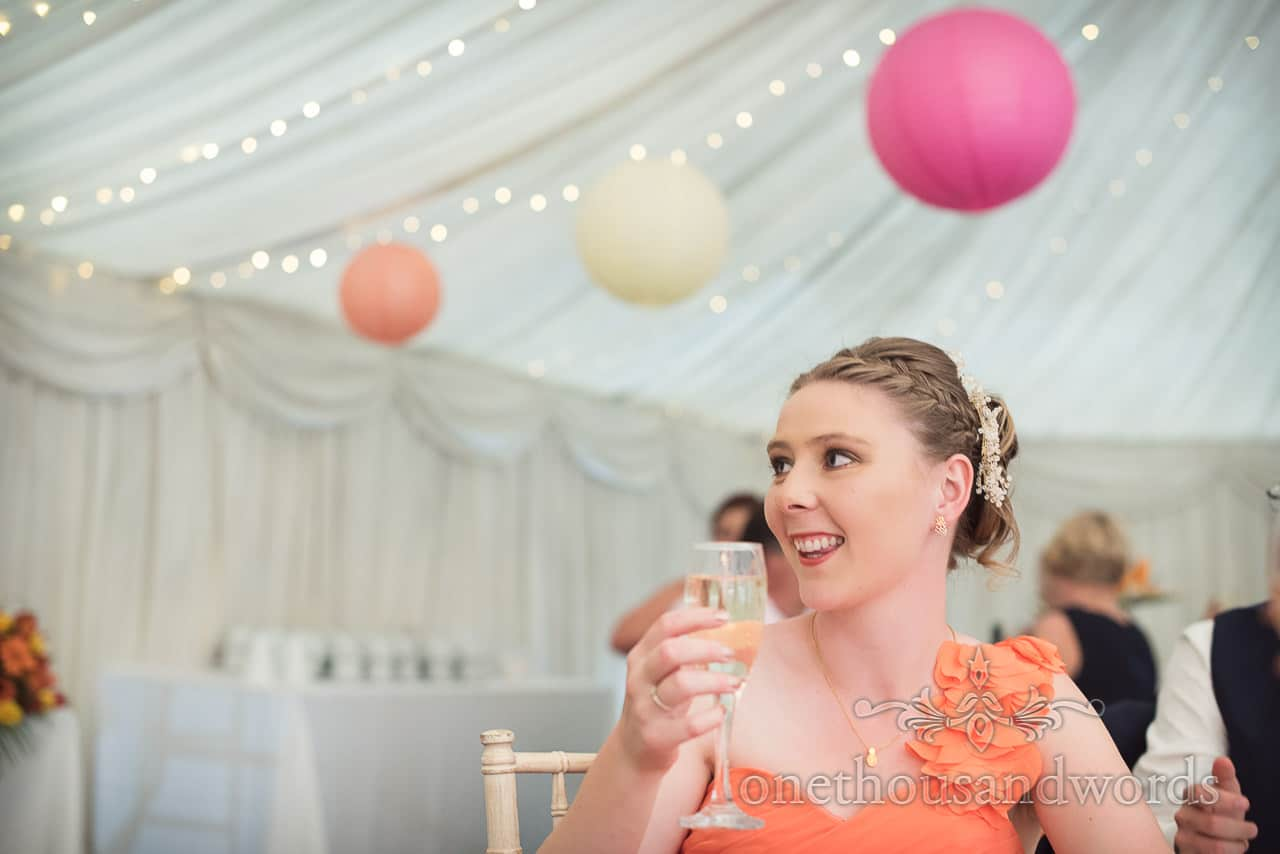 Bridesmaid raises glass during speeches at The Old Vicarage Wedding