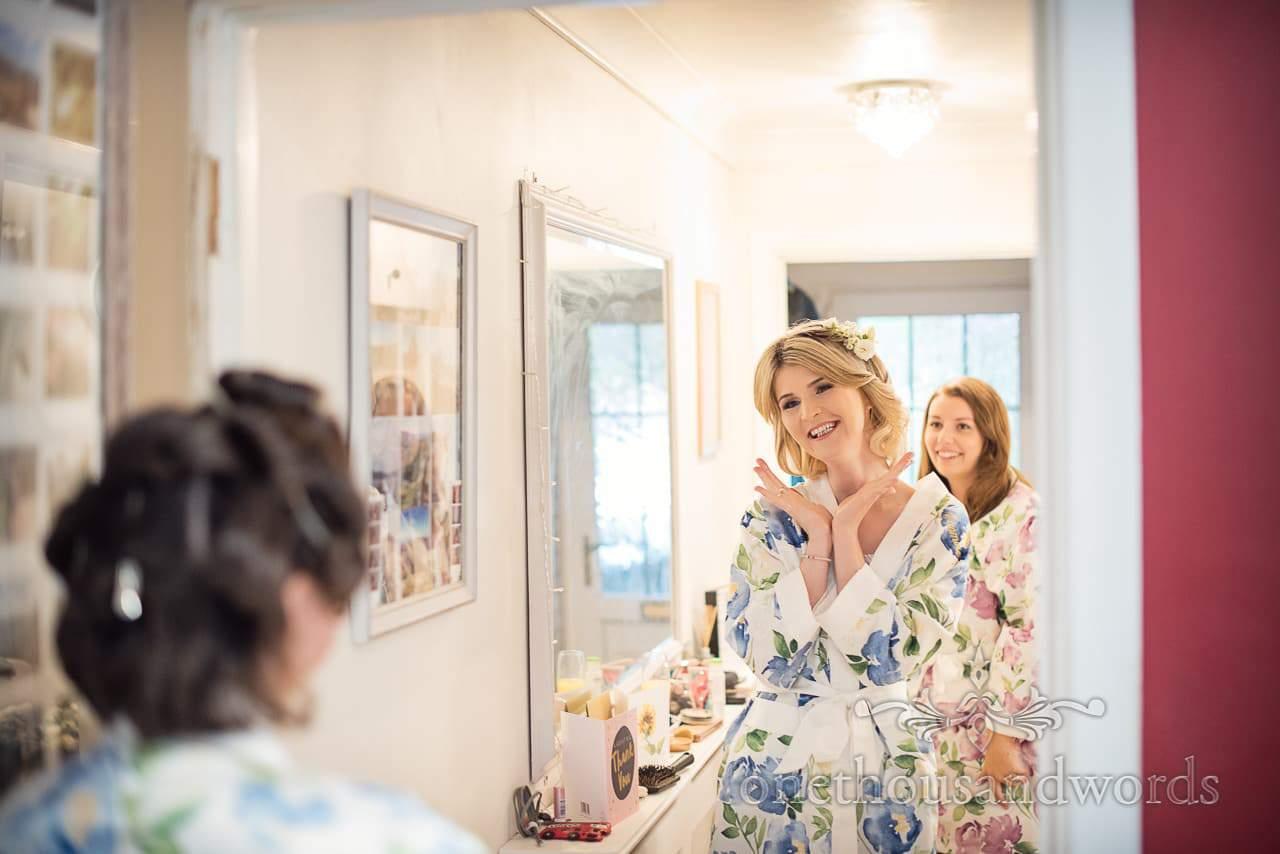 Bridesmaids in mirror on morning of Italian Villa Wedding