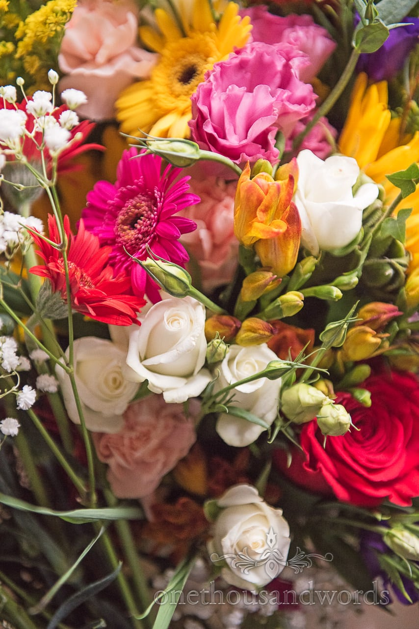 Bright colors in bridal bouquet at Woodsford castle
