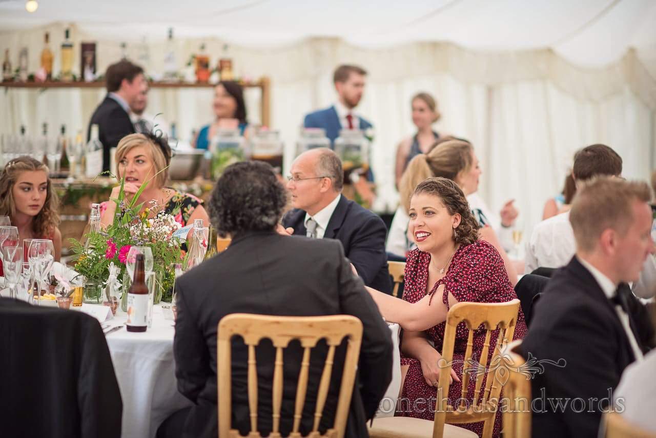 Celebrant during marquee reception at garden wedding
