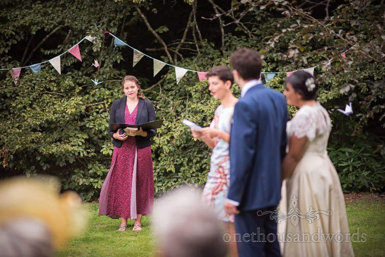 Celebrant during reading at Dorset garden wedding ceremony