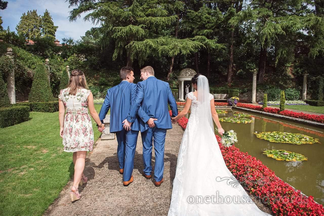 Cheeky group photo in garden at the Italian Villa Wedding Venue