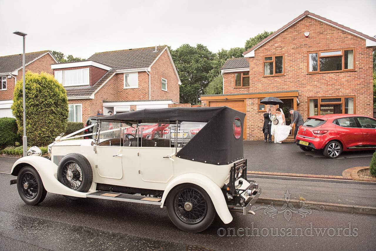 Classic wedding car outside parents house before Canford School Wedding