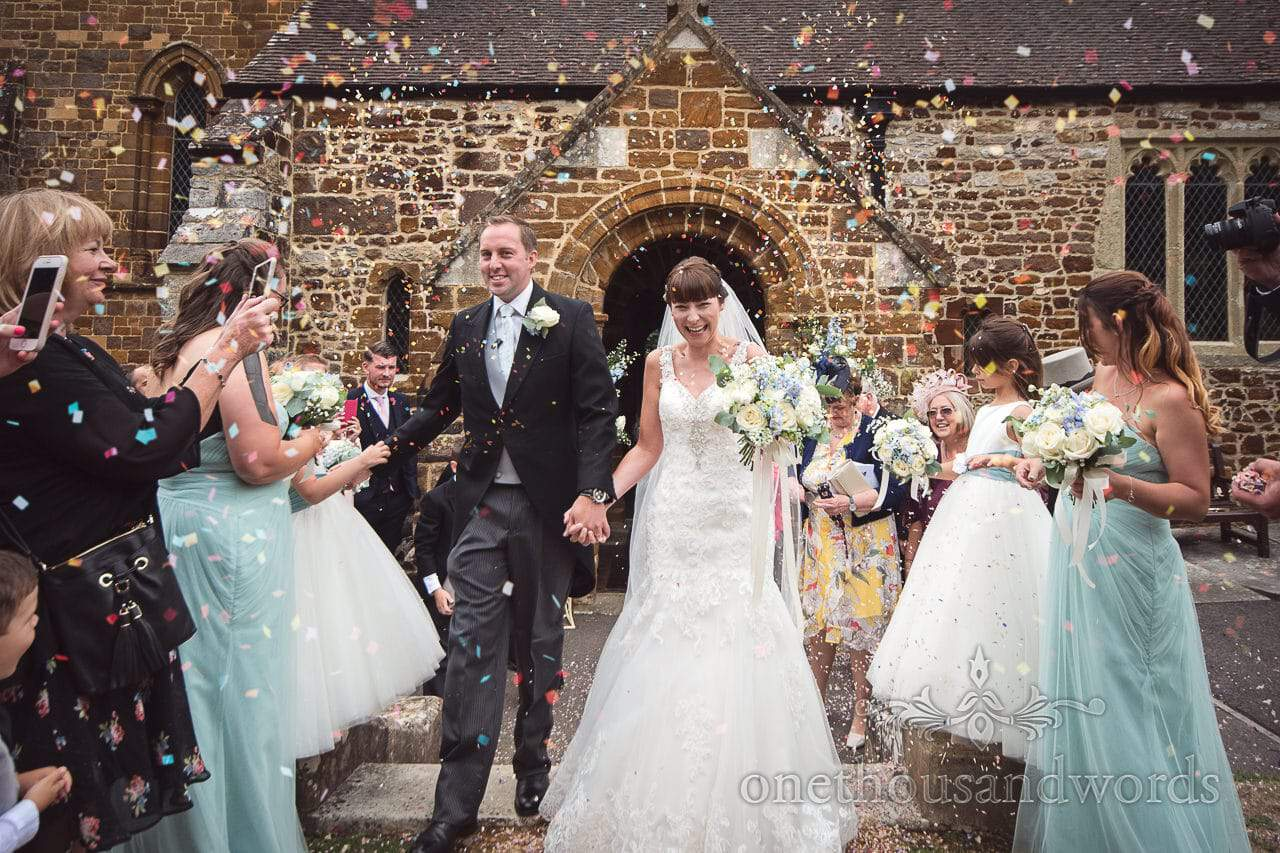 Confetti shower at Canford School Wedding Photographs