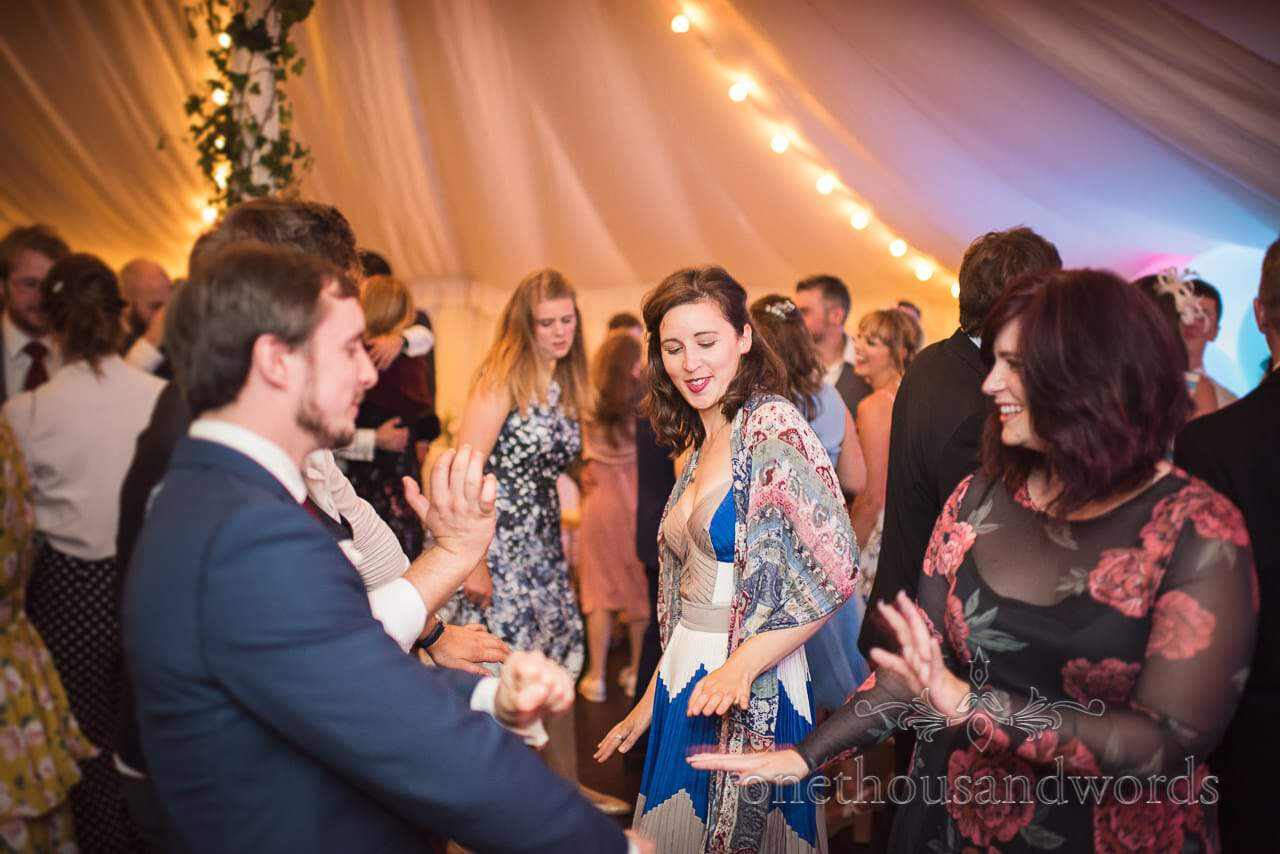 Dancing guests during marquee wedding reception