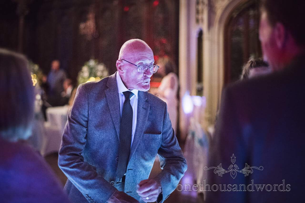 Elderly guest throws shapes on dance floor from Canford School Wedding Photographs