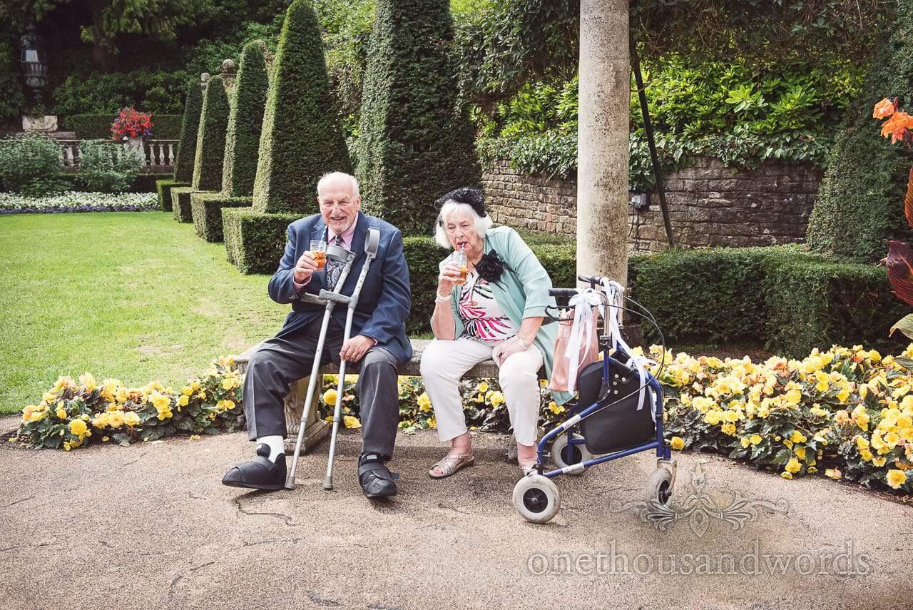 Elderly guests take a break in garden at the Italian Villa Wedding venue