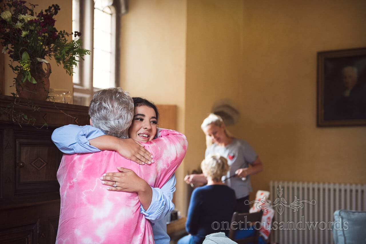Embrace during morning preparations at Woodsford castle